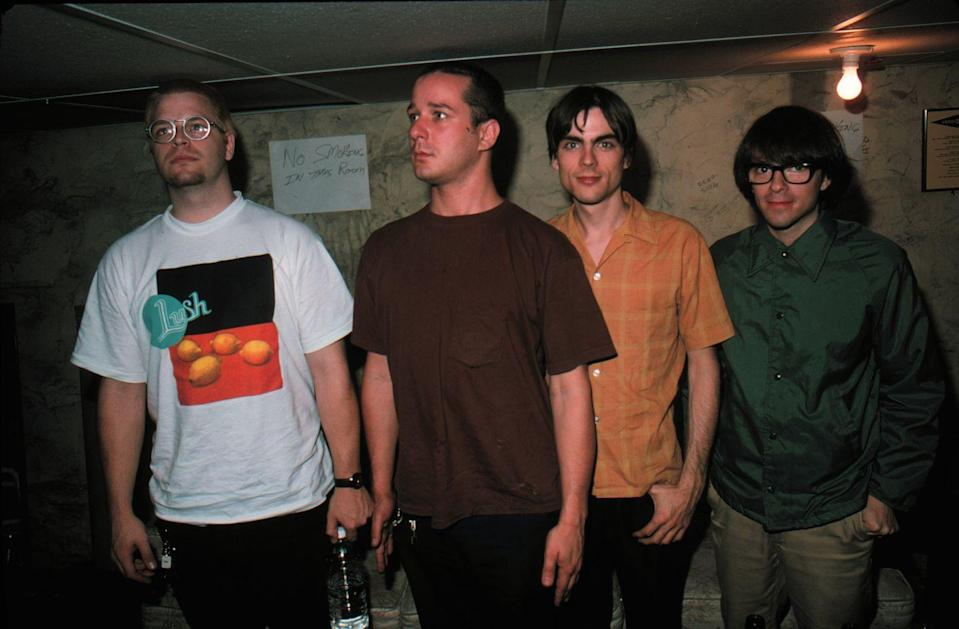 """<p>The laid-back rock band formed in 1992 in Los Angeles, California, and their self-titled debut housed hit songs like """"Buddy Holly,"""" """"Undone - The Sweater Song"""" and """"Say It Ain't So."""" Along with some super clever videos, they became known for smashes like """"Hash Pipe"""" and """"Beverly Hills.""""</p>"""