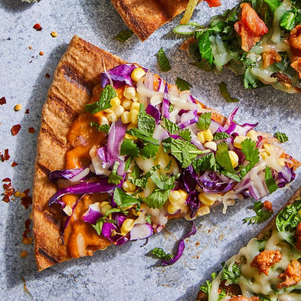 """<p>Thai peanut sauce is an addictive base for homemade grilled pizza. Purchase your preferred brand at any large supermarket or Asian grocery store for an easy, veggie-loaded pizza made right at home. <a href=""""http://www.eatingwell.com/recipe/263888/thai-peanut-herb-grilled-pizza/"""" rel=""""nofollow noopener"""" target=""""_blank"""" data-ylk=""""slk:View recipe"""" class=""""link rapid-noclick-resp""""> View recipe </a></p>"""