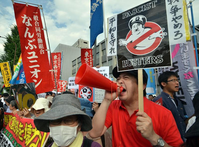 Protestors rally in front of the prime minister's residence in Tokyo on July 1, 2014 against Shinzo Abe's loosening of restrictions on Japan's military, allowing it to go into battle in defence of allies