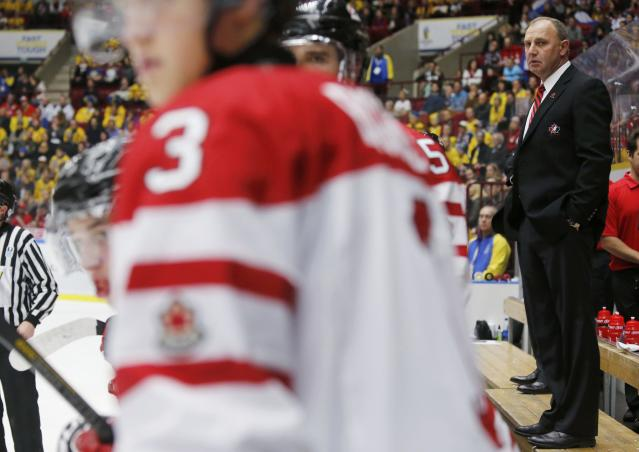 Canada's head coach Brent Sutter looks on as his team plays Russia during the second period of their IIHF World Junior Championship ice hockey game in Malmo, Sweden, January 5, 2014. REUTERS/Alexander Demianchuk (SWEDEN - Tags: SPORT ICE HOCKEY)