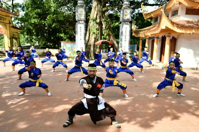 Master Nguyen Khac Phan (front) leads students through a training class in centuries-old martial art Thien Mon Dao inside the Bach Linh temple compound at Du Xa Thuong village in Hanoi (AFP Photo/Manan VATSYAYANA)