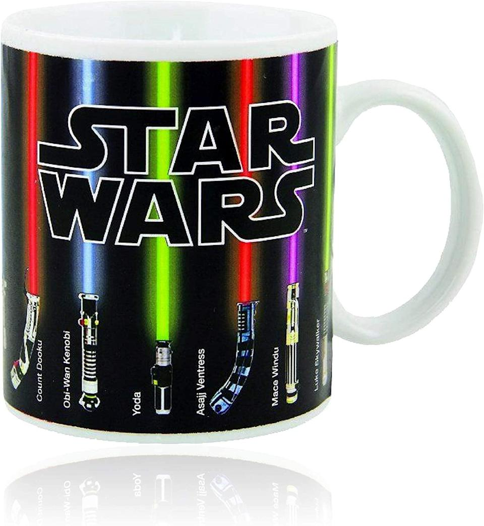 <p>The lightsabers on the <span>Star Wars Lightsabers Mug</span> ($15) light up with heat.</p>