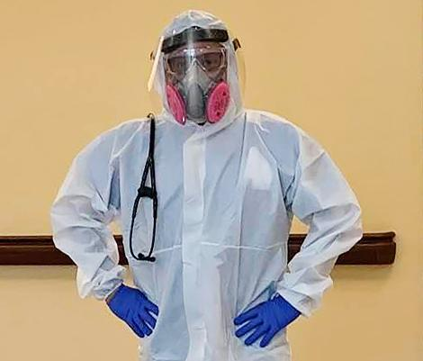 Dr. Araujo-Preza prepared for work in the Covid-19 unit. (Courtesy of Paige King)