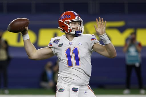 Florida quarterback Kyle Trask throws a pass during the first half of the team's Cotton Bowl NCAA college football game against Oklahoma in Arlington, Texas, Wednesday, Dec. 30, 2020. (AP Photo/Ron Jenkins)