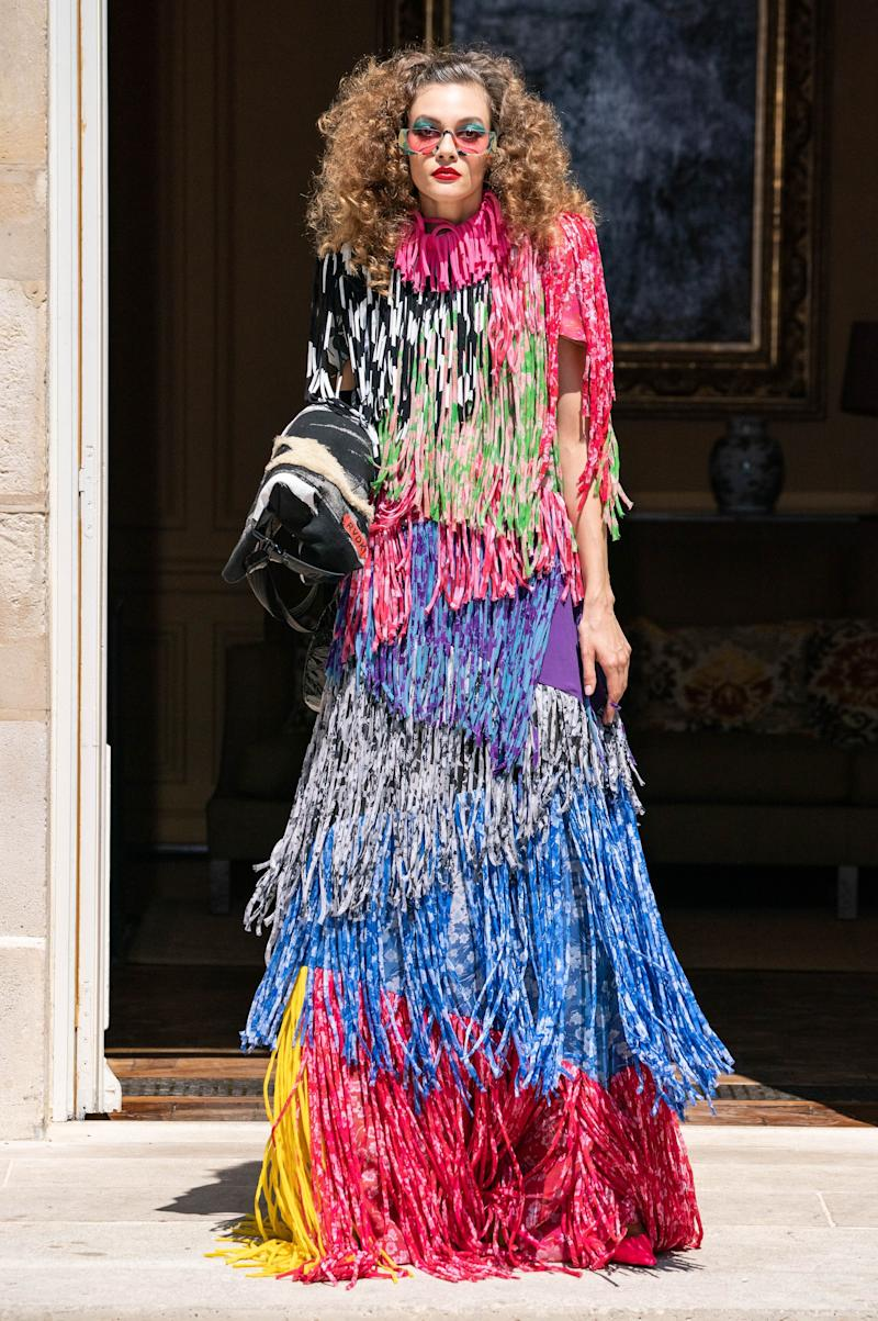 "Ronald van der Kemp's couture collections are made from nearly 100 percent upcycled or reconstructed materials, including this dress, which was painstakingly handmade. ""Each piece of fringe was cut on the bias, turned inside out, and sewn into a tube,"" he told Vogue's Nicole Phelps. ""I love it because it's real couture."""