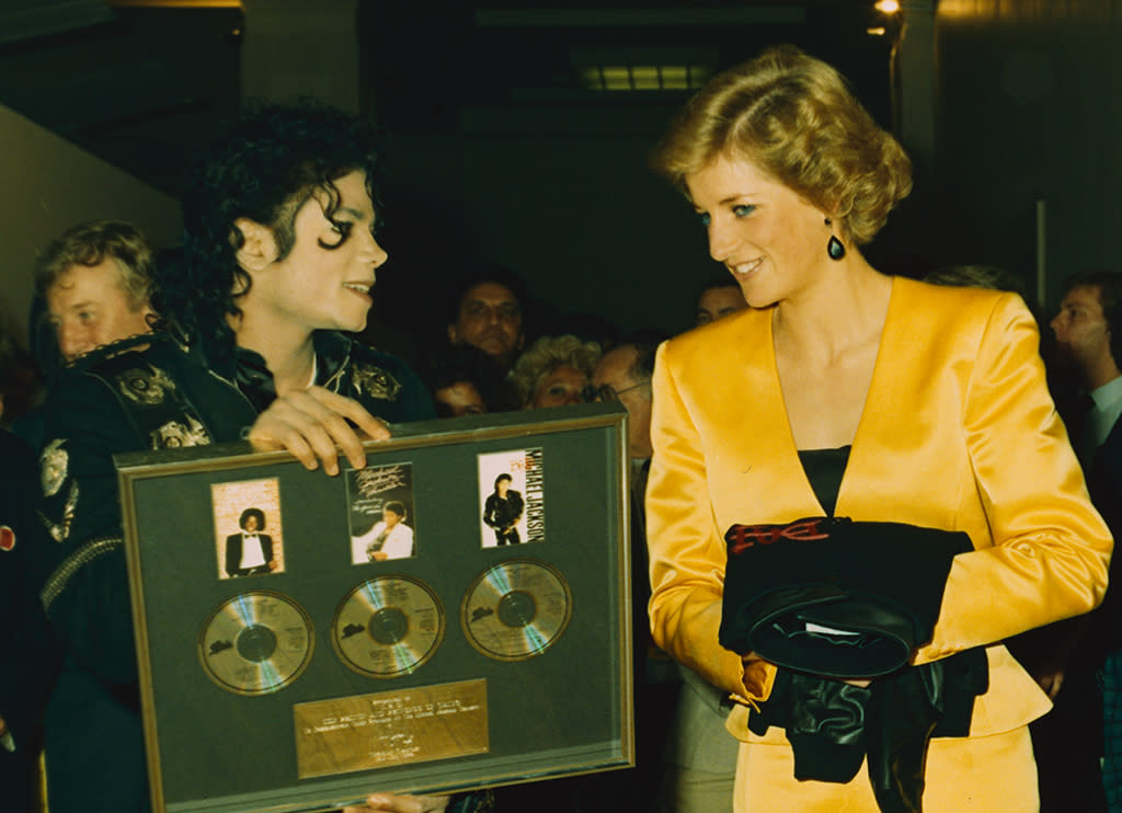 """<p>Princess Diana was a huge music fan, and she was thrilled to meet the King of Pop when he performed at London's Wembley Stadium on his <em>Bad</em> tour in 1988. Afterwards, they began talking over the phone, mostly late at night for him, and bonded over their disdain for the tabloids. """"We could relate to each other,"""" he said in the 2003 TV doc <i>Michael Jackson's Private Home Movies</i>. """"We shared something in common with the press. I don't think they hounded any one more than her and myself."""" He added that they would """"cry on each other's shoulders."""" (Photo: Lynn Goldsmith/Corbis/VCG via Getty Images) </p>"""