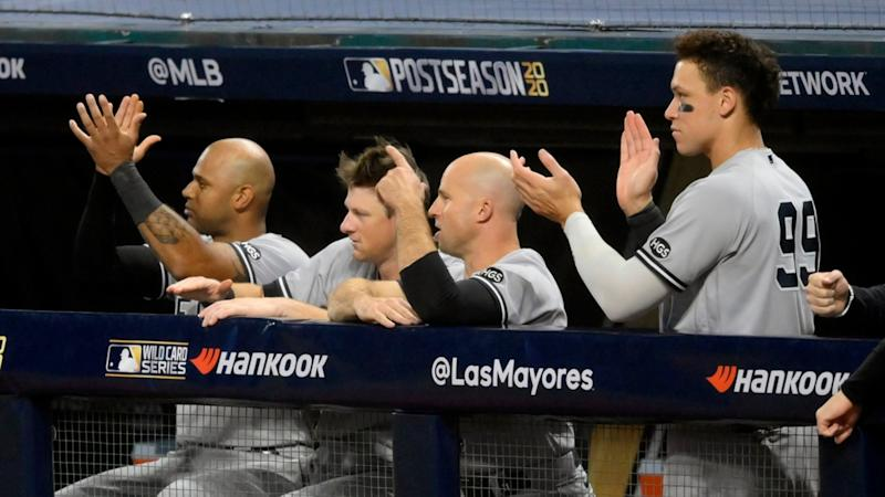 Yankees cheer from dugout during Game 1 victory
