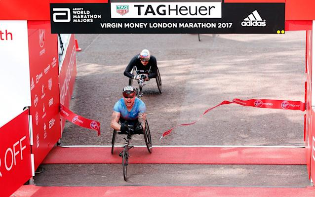David Weir crosses the finish line in first place - REUTERS