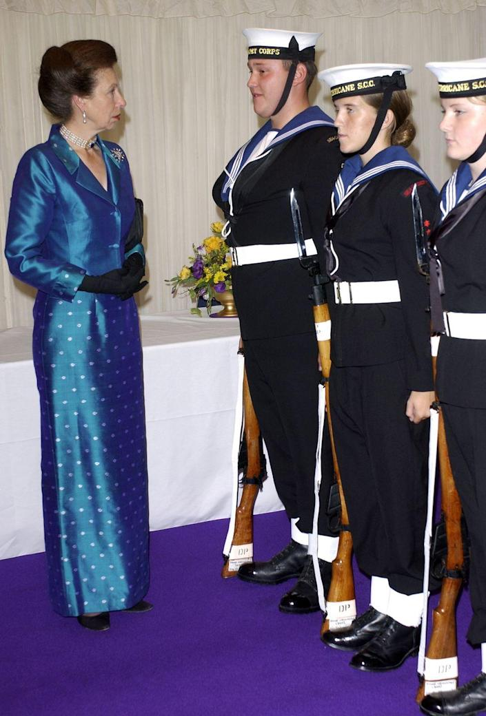 <p>Princess Anne wore a matching silk dress and jacket with dot detailing in the skirt for a dinner held at the Royal Victoria Dock.</p>