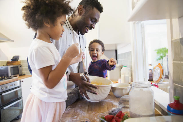 Father and toddler children baking in kitchen (Getty Images)