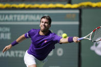 Cameron Norrie, of Britain, returns to Diego Schwartzman, of Argentina, at the BNP Paribas Open tennis tournament Thursday, Oct. 14, 2021, in Indian Wells, Calif. (AP Photo/Mark J. Terrill)