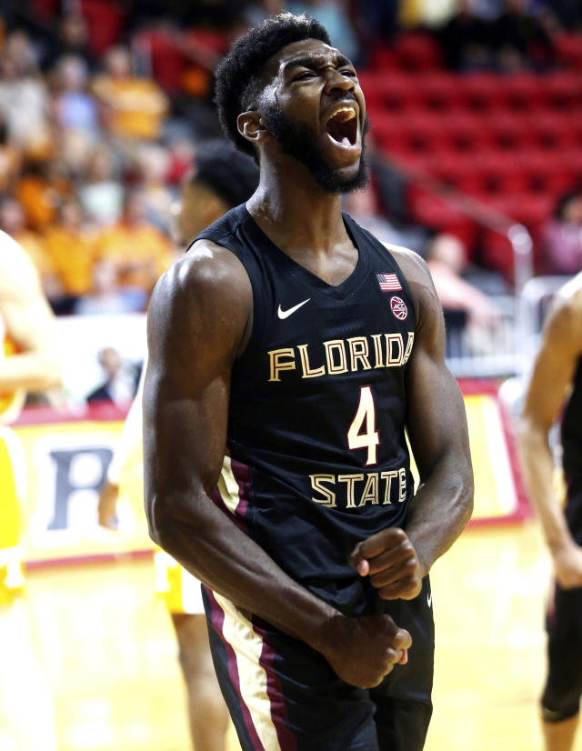Florida State's Patrick Williams reacts after being fouled by Tennessee defenders in the first half of an NCAA college basketball game in Niceville, Fla., Friday, Nov. 29, 2019. (Michael Snyder/Northwest Florida Daily News via AP)