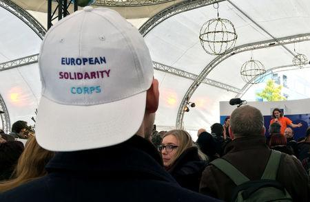 Youths attend the launch of the European Solidarity Corps, a new initiative for young people to travel and help out people in difficulty across the continent, outside the European Commission headquarters in Brussels, Belgium December 7, 2016.   REUTERS/Marilyn Haigh