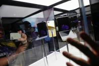 Attendees look at a Samsung Z Flip foldable smartphone during Samsung Galaxy Unpacked 2020 in San Francisco