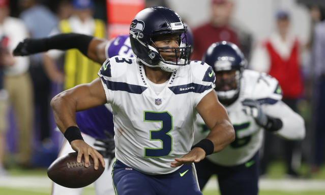 FILE - In this Friday, Aug. 24, 2018, file photo, Seattle Seahawks quarterback Russell Wilson looks to throw a pass during the second half of an NFL preseason football game against the Minnesota Vikings, in Minneapolis. While star power still remains led by Wilson, receiver Doug Baldwin and linebacker Bobby Wagner, the rest of the roster likely has too many holes for the Seahawks to be able to challenge the top teams in the NFC. (AP Photo/Jim Mone, File)