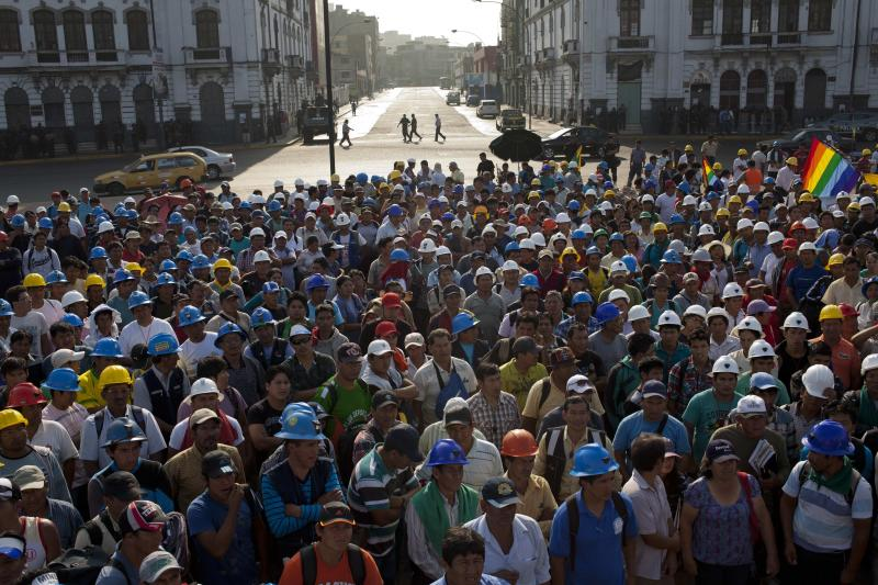 Miners listen to one of their leaders during a protest organized by artisanal and small-scale gold miners in Lima, Peru, Friday, March 21, 2014. The miners marched in the country's capital for a second day asking the government to repeal regulations aimed at formalizing informal miners. (AP Photo/Rodrigo Abd)(AP Photo/Rodrigo Abd)