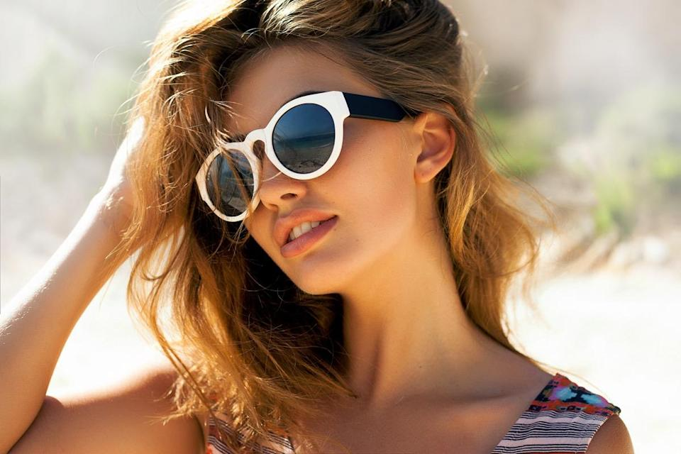 Bright lifestyle fashion portrait of sensual beautiful young woman having fun smiling pretty , natural beauty face,skin care, bright casual trendy sunglasses