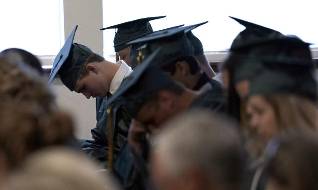 <p>Santa Fe High School graduates bow their heads in prayer during a Baccalaureate service Sunday, May 20, 2018, in Santa Fe, Texas. (Photo: David J. Phillip/AP) </p>