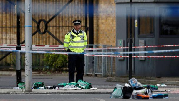 PHOTO: A police officer stands behind discarded medical equipment near Borough Market after an attack left 7 people dead and dozens injured in London, June 4, 2017. (Peter Nicholls/Reuters)