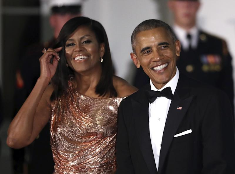 President Barack Obama and first lady Michelle Obama wait at North Portico of the White House to greet Italian Prime Minister Matteo Renzi and his wife Agnese Landini, for a State Dinner at the White House in Washington, Tuesday, Oct. 18, 2016. (AP Photo/Manuel Balce Ceneta)