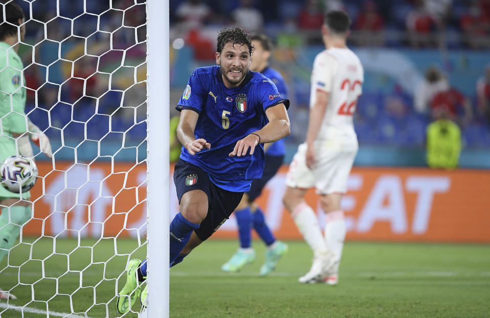 Italy's Manuel Locatelli celebrates after scoring his side's opening goal during the Euro 2020 soccer championship group A match between Italy and Switzerland at Olympic stadium in Rome, Wednesday, June 16, 2021. (Ettore Ferrari, Pool via AP)