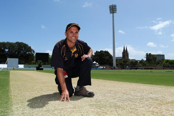 ADELAIDE, AUSTRALIA - NOVEMBER 21: Curator Damian Hough looks at the pitch before the test at Adelaide Oval on November 21, 2012 in Adelaide, Australia.  (Photo by Morne de Klerk/Getty Images)