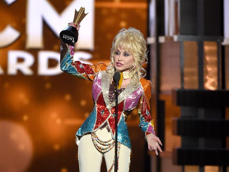 <p>Parton accepts the Willie Nelson Lifetime Achievement Award at the 2015 Country Music Awards. If only that sequined jacket could've gotten an achievement award of its own. </p>