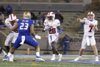 SMU running back Ulysses Bentley IV (26) looks for a hole against Tulsa during the second half of an NCAA college football game in Tulsa, Okla., Saturday, Nov. 14, 2020. (AP Photo/Joey Johnson)