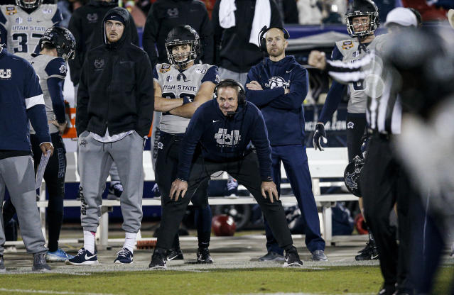 Utah State coach Gary Anderson watches from the sideline during the second half of the team's Frisco Bowl NCAA college football game against Kent State on Friday, Dec. 20, 2019, in Frisco, Texas. Kent State won 51-41. (AP Photo/Brandon Wade)