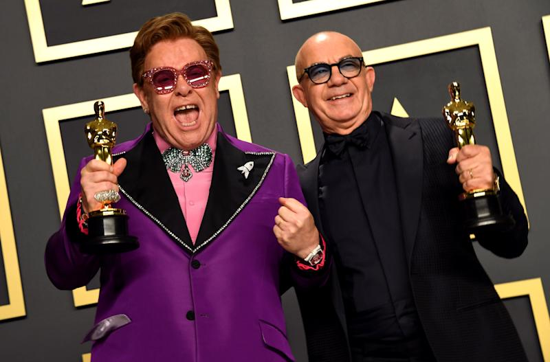 Elton John and Bernie Taupin with their Best Original Song Oscar for in the press room at the 92nd Academy Awards. (Photo: Jennifer Graylock - PA Images via Getty Images)