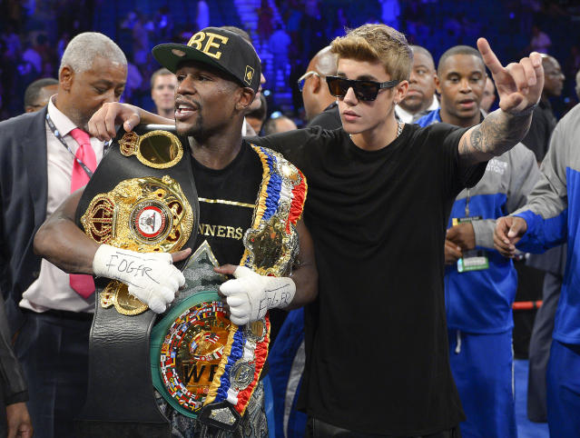 Floyd Mayweather Jr. poses for photos with Justin Bieber after defeating Canelo Alvarez on Sept. 14, 2013, in Las Vegas. (AP)