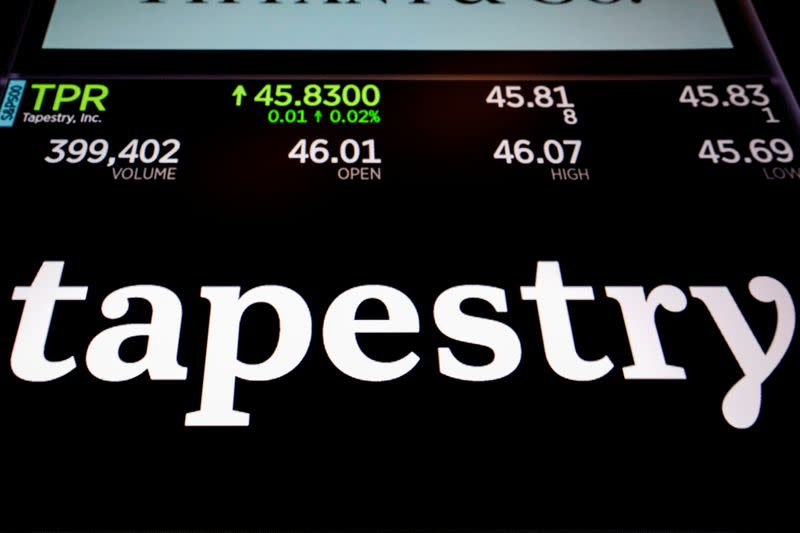 Tapestry Inc. logo and trading information are displayed on a screen on the floor of the NYSE in New York