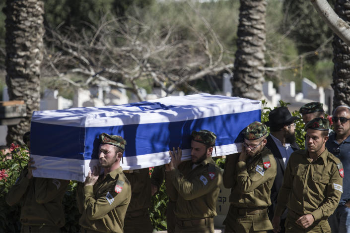 Comrades of killed Israeli soldier Staff Sgt. Yovel Mor Yosef carry his coffin during his funeral in Ashkelon, Israel, Friday, Dec. 14, 2018. Yosef was one of two Israeli soldiers killed by Palestinian gunman in the West Bank Thursday, Israel, Friday, Dec. 14, 2018. (AP Photo/Tsafrir Abayov)