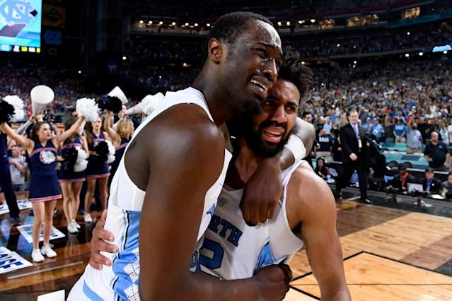 <p>Theo Pinson #1 and Joel Berry II #2 of the North Carolina Tar Heels embrace after time expires during the 2017 NCAA Men's Final Four National Championship game against the Gonzaga Bulldogs at University of Phoenix Stadium on April 3, 2017 in Glendale, Arizona. (Photo by Brett Wilhelm/NCAA Photos via Getty Images) </p>