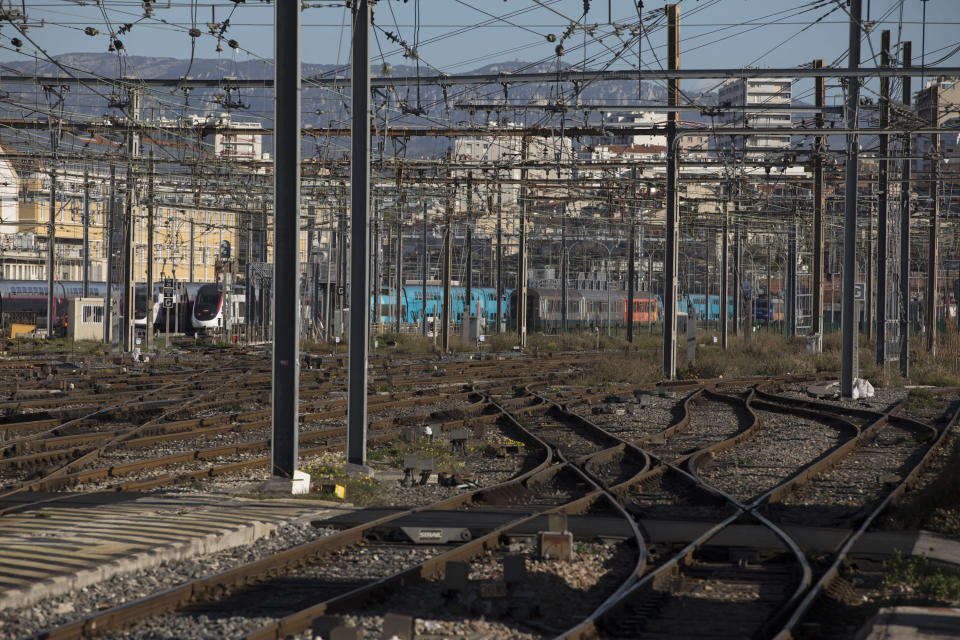 Empty rail tracks at the Gare St-Charles station in Marseille, southern France, Monday, Dec. 9, 2019. Paris commuters inched to work Monday through exceptional traffic jams, as strikes to preserve retirement rights halted trains and subways for a fifth straight day. (AP Photo/Daniel Cole)