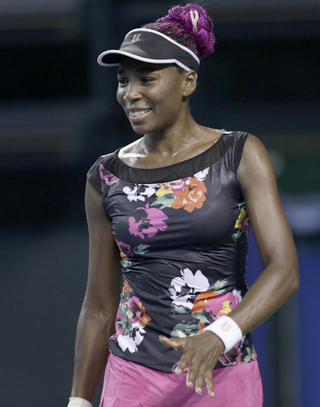 Venus Williams of U.S. reacts after getting a point against Simona Halep of Romania during their third round match of the Pan Pacific Open tennis tournament in Tokyo, Wednesday, Sept. 25, 2013. Williams won 4-6, 7-5, 6-3. (AP Photo/Shizuo Kambayashi)