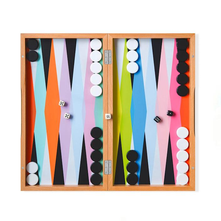 """Appeal to his competitive nature with this colorful backgammon sets that's just as fun to play as it is to look at. $96, MoMA Design Store. <a href=""""https://store.moma.org/kids/toys-games/colorful-backgammon-set/128691-128691.html?"""" rel=""""nofollow noopener"""" target=""""_blank"""" data-ylk=""""slk:Get it now!"""" class=""""link rapid-noclick-resp"""">Get it now!</a>"""