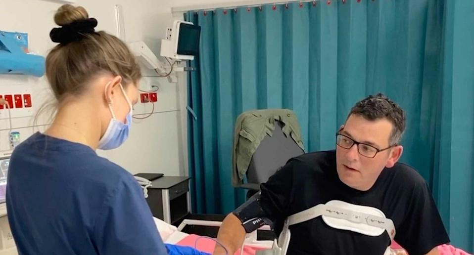 Victorian Premier Dan Andrews seen in hospital after injuring his back.