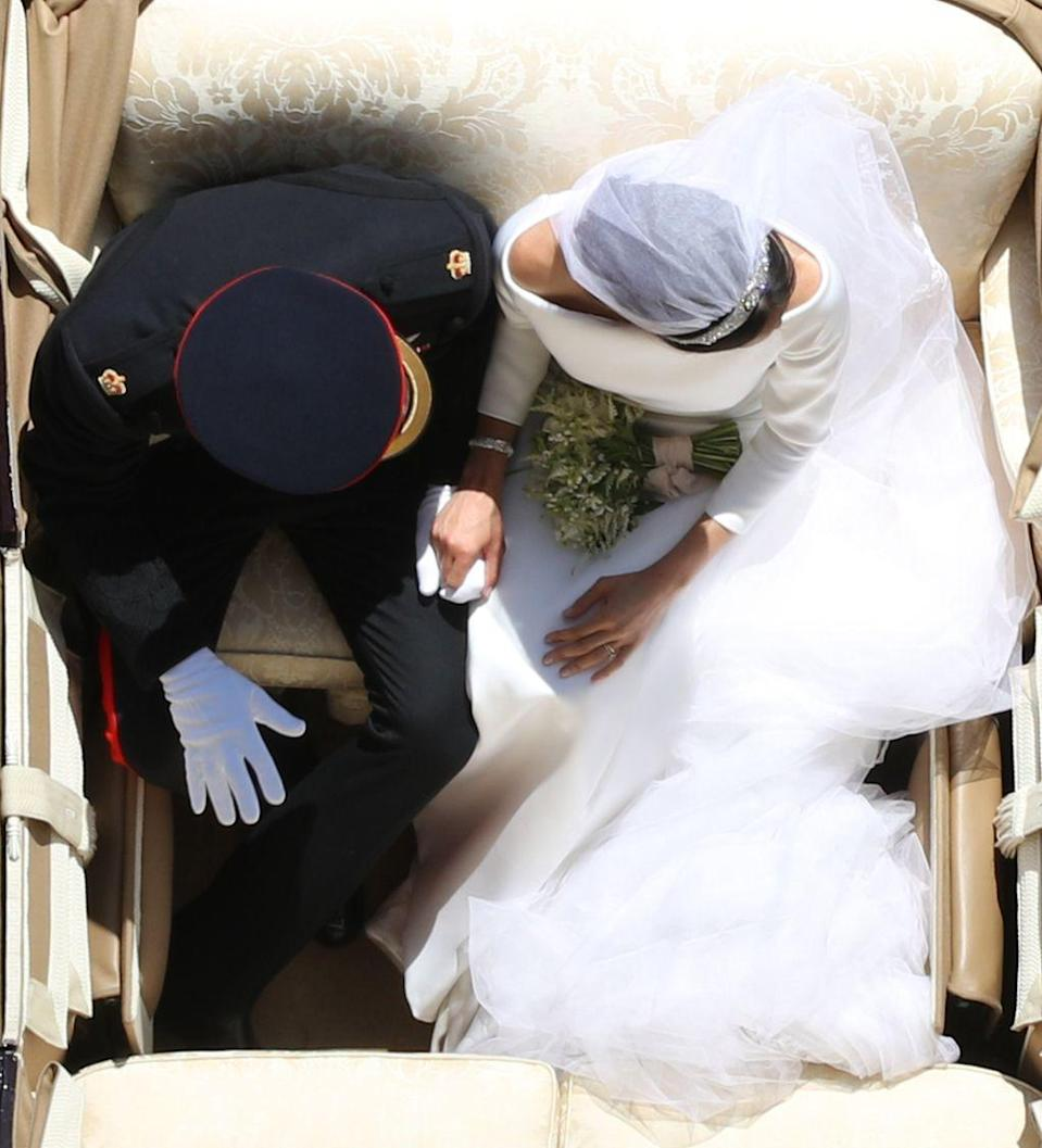 """<p>Prince Harry and Meghan Markle share an intimate moment as they process in an open carriage from St George's Chapel at Windsor Castle to Buckingham Palace after <a href=""""https://www.townandcountrymag.com/royal-wedding-2018/"""" rel=""""nofollow noopener"""" target=""""_blank"""" data-ylk=""""slk:their wedding ceremony"""" class=""""link rapid-noclick-resp"""">their wedding ceremony</a>.</p>"""