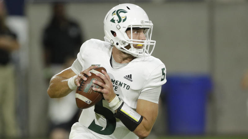 Sacramento State quarterback Kevin Thomson (5) looks to pass against Arizona State during the first half of an NCAA college football game, Friday, Sept. 6, 2019, in Tempe, Ariz. (AP Photo/Matt York)