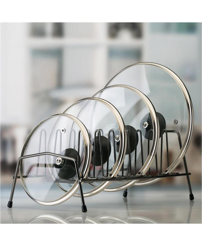 """<p>This <a href=""""https://www.popsugar.com/buy/Kitchen-Details-Organizer-491555?p_name=Kitchen%20Details%20Organizer&retailer=macys.com&pid=491555&price=14&evar1=savvy%3Aus&evar9=46637119&evar98=https%3A%2F%2Fwww.popsugar.com%2Fsmart-living%2Fphoto-gallery%2F46637119%2Fimage%2F46637188%2FKitchen-Details-Lid-Organizer&list1=shopping%2Cgift%20guide%2Cmacys&prop13=api&pdata=1"""" rel=""""nofollow"""" data-shoppable-link=""""1"""" target=""""_blank"""" class=""""ga-track"""" data-ga-category=""""Related"""" data-ga-label=""""https://www.macys.com/shop/product/kitchen-details-lid-organizer?ID=9005481&amp;CategoryID=206384#fn=sp%3D3%26spc%3D4429%26ruleId%3D78%7CBOOST%20ATTRIBUTE%7CBOOST%20SAVED%20SET%26searchPass%3DmatchNone%26slotId%3D10"""" data-ga-action=""""In-Line Links"""">Kitchen Details Organizer</a> ($14) will save your cabinets from overflowing with lids.</p>"""