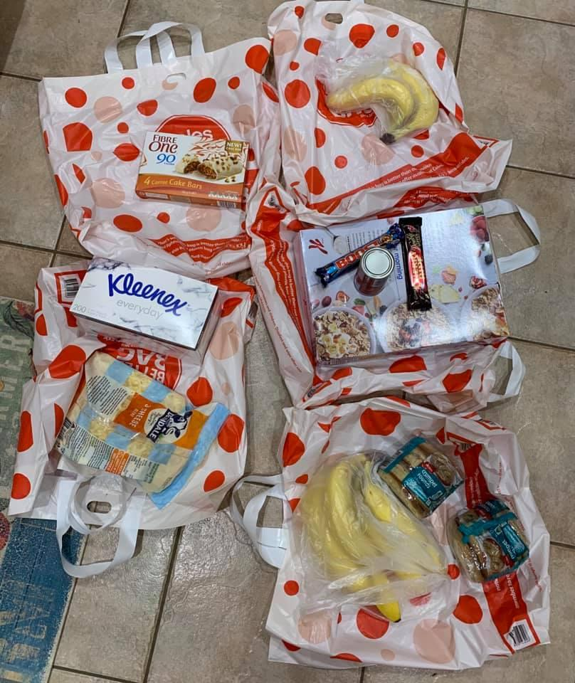 A number of Coles reusable bags are pictured.