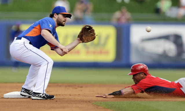 FILE - In this March 7, 2014, file photo, St. Louis Cardinals' Kolten Wong, right, steals second as New York Mets second baseman Daniel Murphy bobbles the throw during the first inning of an exhibition spring training baseball game in Port St. Lucie, Fla. Murphy is proud he put fatherhood ahead of baseball, and New York Mets manager Terry Collins thinks criticism his second baseman received for taking paternity leave this week was unfair. Murphy made his season debut Thursday, April 3, three days after the birth of son Noah. (AP Photo/Jeff Roberson, File)