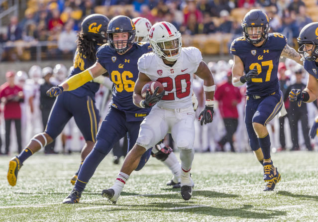 Bryce Love #20 of the Stanford Cardinal runs for yardage during the 121st Big Game between Stanford and California. (Photo by David Madison/Getty Images)