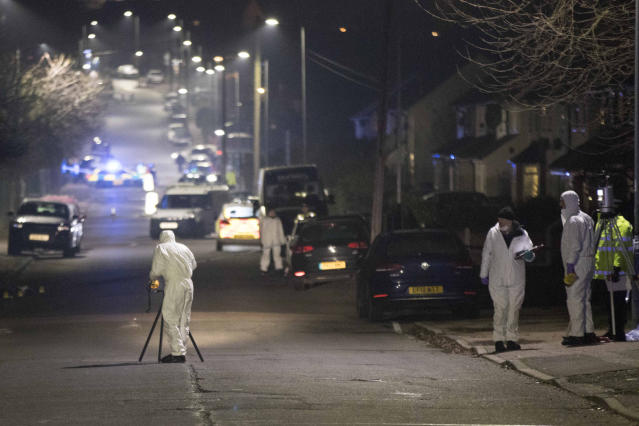 Forensic officers in Willingdale Road near Debden Park High School after the crash (PA/Getty)