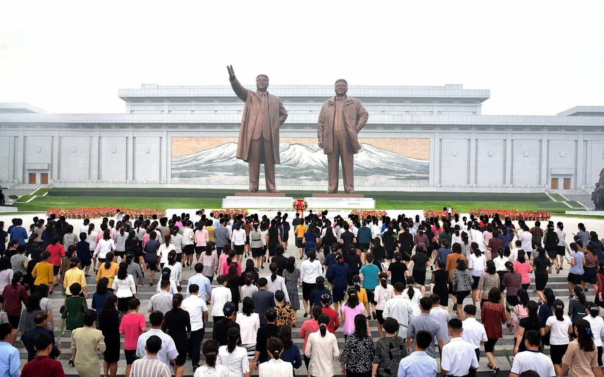 North Koreans paying tribute at the monuments of late leaders Kim Il-sung and Kim Jong-il in Pyongyang in September 2017 - YNA