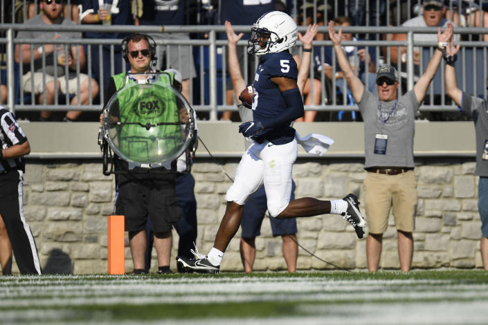 Penn State wide receiver Jahan Dotson (5) scores on a 25-yard touchdown pass in the second quarter against Ball State during an NCAA college football game in State College, Pa., Saturday, Sept. 11, 2021. (AP Photo/Barry Reeger)