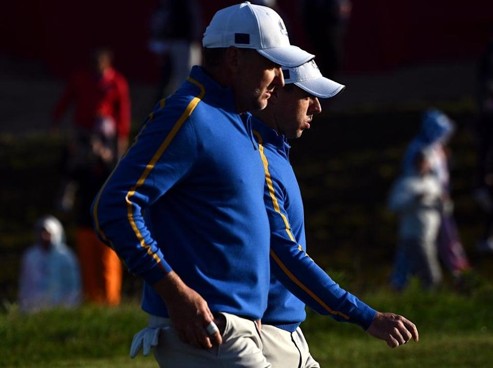 Rory McIlroy (right) and Ian Poulter walk up the first hole during the foursomes on day one of the 43rd Ryder Cup at Whistling Straits (Anthony Behar/PA) (PA Wire)