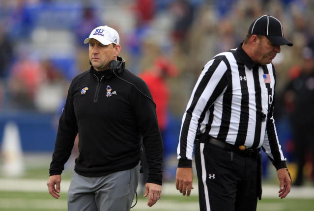 Kansas head coach David Beaty, left, during the first half of an NCAA college football game against Baylor in Lawrence, Kan., Saturday, Nov. 4, 2017. (AP Photo/Orlin Wagner)