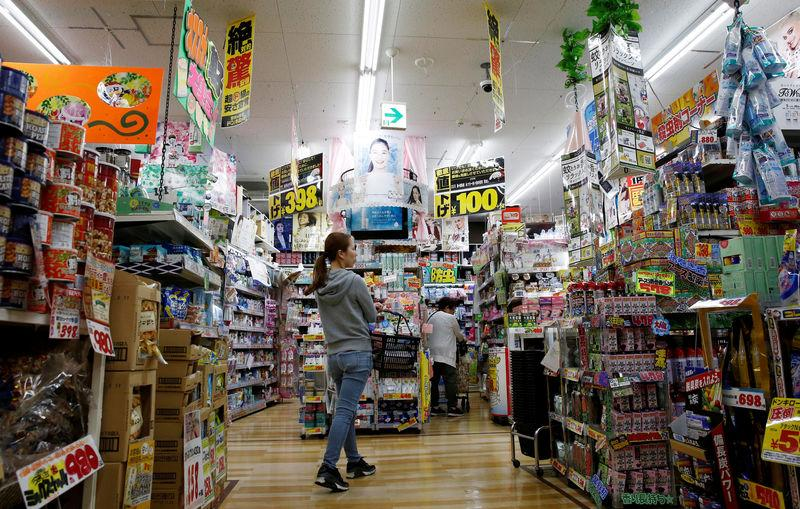 FILE PHOTO: Shoppers browse products at Japanese discount retailer Don Quijote Holdings' store in Tokyo